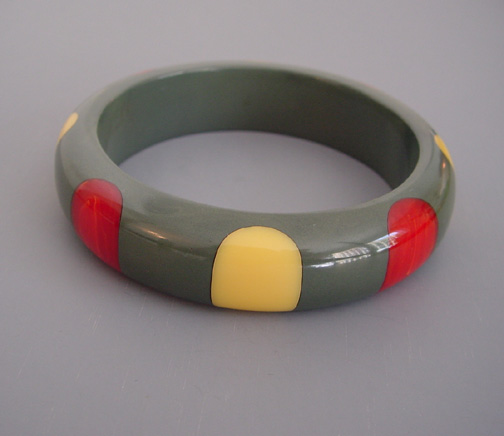 SHULTZ bakelite slate gray bangle with red marbled and yellow dots