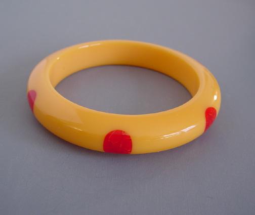 SHULTZ bakelite peachy yellow bangle with red dots