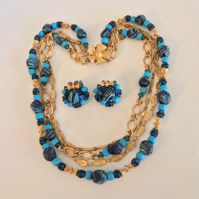 HATTIE CARNEGIE aqua and dark blue glass peacock swirl bead necklace and clip back earrings