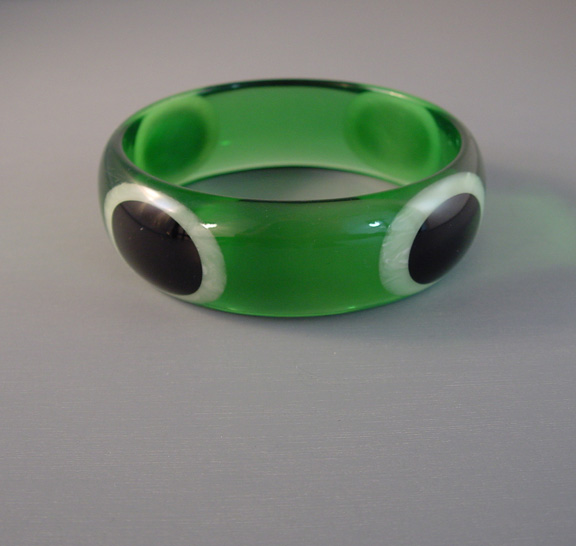 SHULTZ transparent green Lucite bangle with black and white oval dots