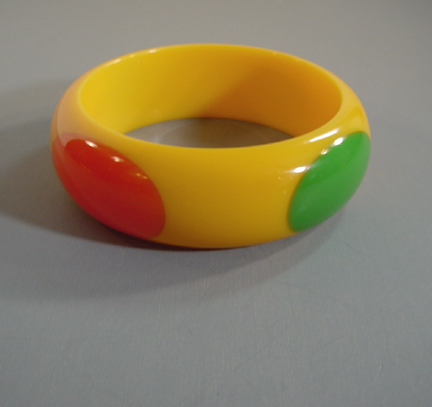 SHULTZ bakelite yellow bangle with red, green and black dots