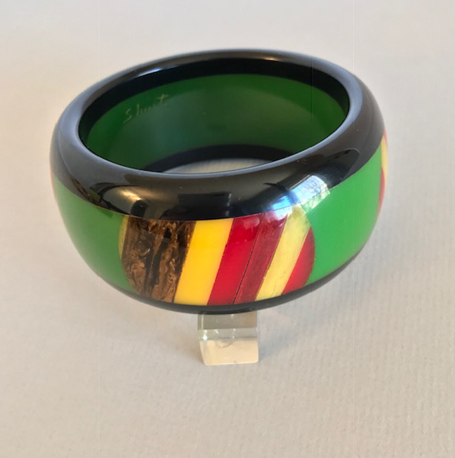 SHULTZ bakelite bangle with three laminated layers of green and black, striped oval dots