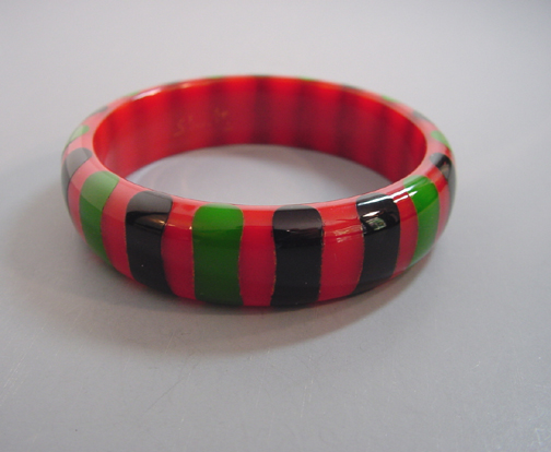 SHULTZ bakelite slightly translucent red bangle with black and green bowtie dots