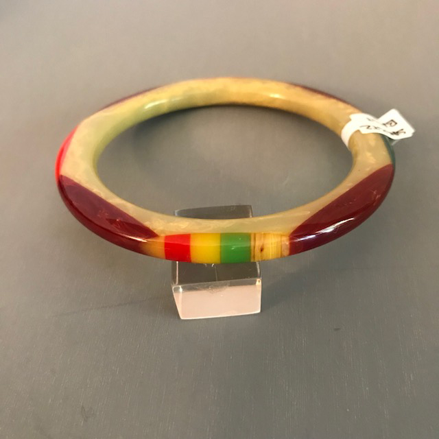 SHULTZ bakelite tube spacer bangle in light green with cream marbling and overlapping oval dots
