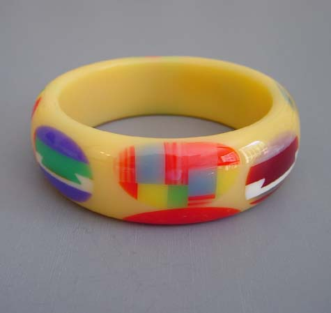 SHULTZ bakelite cream with multi-color dots and dovetails bangle
