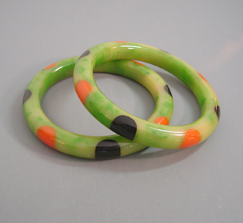 SHULTZ  bakelite green with cream marbling bangles with black and orange dots, set of 2