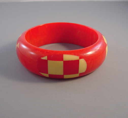 SHULTZ bakelite red bangle with four red and cream checked dots