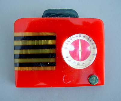 SHULTZ bakelite radio brooch in red, black and marbled yellow