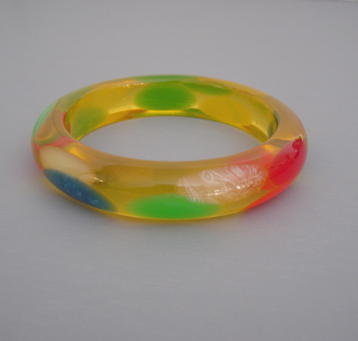SHULTZ bakelite apple juice bangle with translucent oval dots in several colors