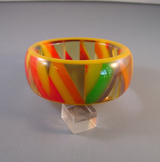 SHULTZ bakelite checked bangle with yellow outer bands, apple juice, and marbled yellow, red, orange, blue and green