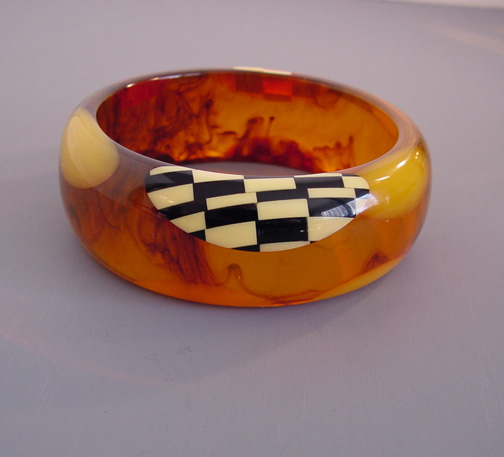 SHULTZ bakelite marbled tortoise colored bangle with checked dots