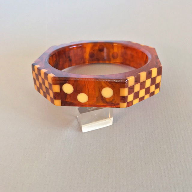 SHULTZ bakelite marbled ice tea bangle with alternating cream checkerboards and round dots