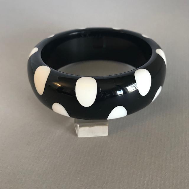 SHULTZ bakelite black bangle white dots alternating on each edge