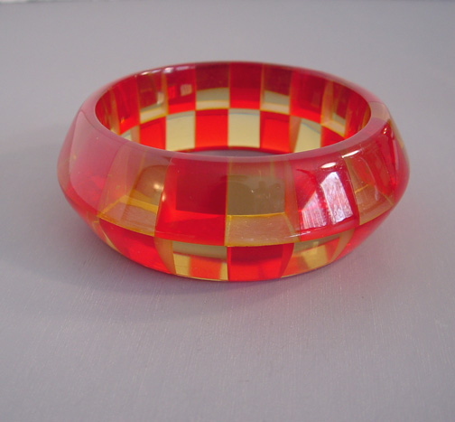 SHULTZ bakelite saucer bangle in transparent red and pale apple juice