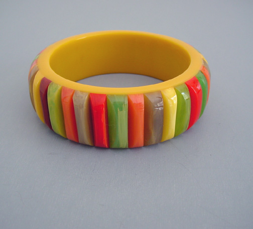 SHULTZ unusual bakelite butterscotch bangle with multi-colored applied ribs, a rainbow of colors