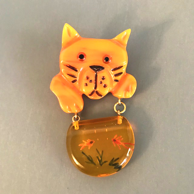 SHULTZ bakelite hand carved cat brooch with dangling fish bowl