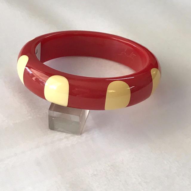 SHULTZ bakelite red bangle with 8 white finger nail dots