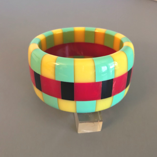 SHULTZ bakelite three row check bangle with red and black center row checks and yellow and green checked