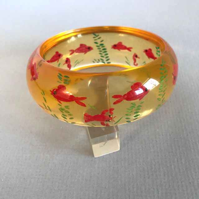 SHULTZ bakelite apple juice domed bangle with fun reverse carved and painted fish