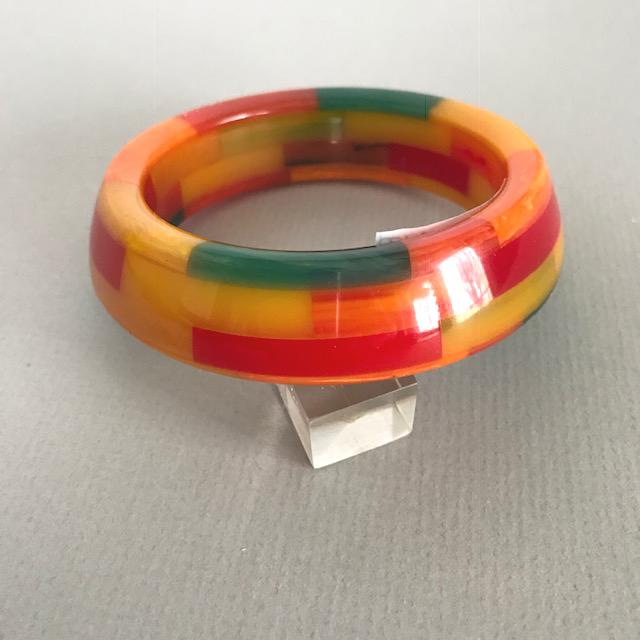 SHULTZ bakelite bangle with four colorful rows of checks, asymmetrical