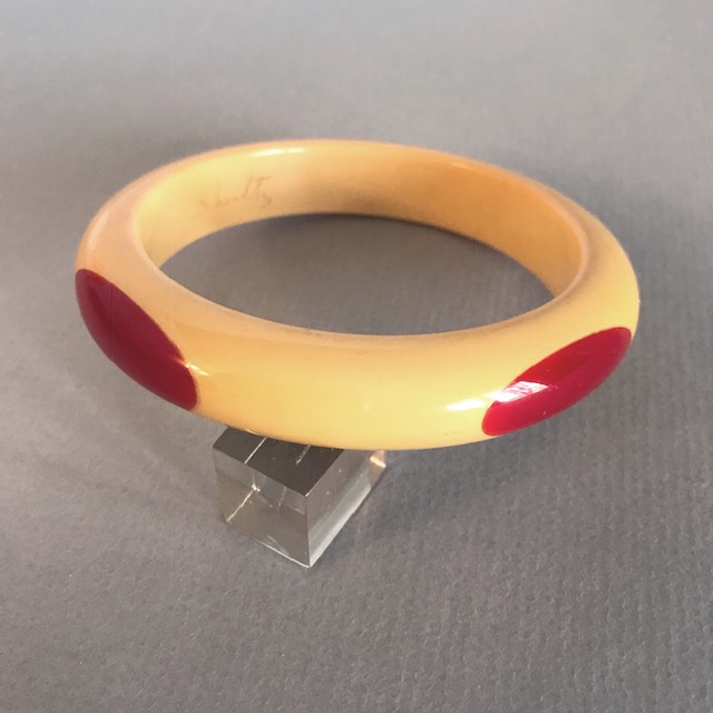 SHULTZ bakelite butter yellow bangle with four red long ovals