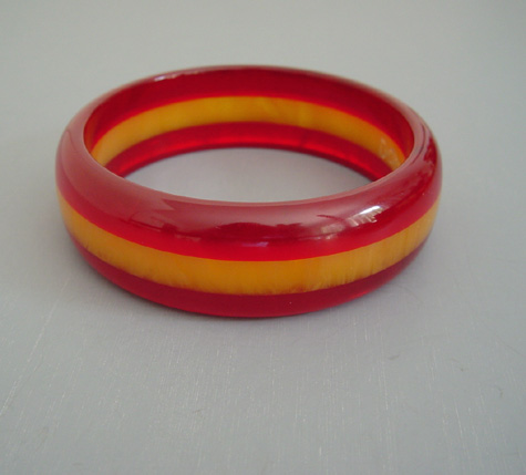 DOMBEK bakelite cherry red transparent and translucent butterscotch marbled laminated bangle