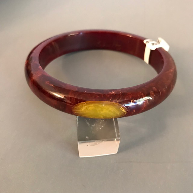 SHULTZ bakelite burgundy moon bangle with yellow marbled dots