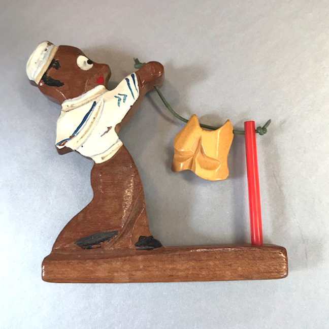 BAKELITE and wood Navy sailor brooch, hanging the wash