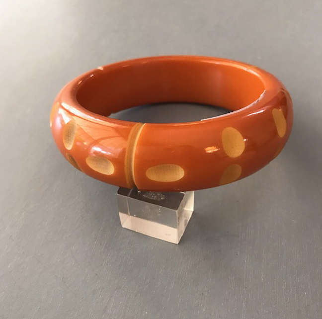 BAKELITE bangle in peach over dyed and cut back to butterscotch