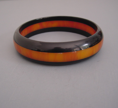 BAKELITE Dombek three row bangle with the two outer rows of black and the center in flame