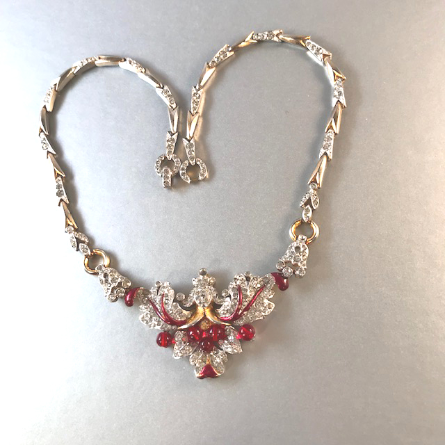 TRIFARI clear rhinestones, red glass beads and rich red enameling necklace, set in silver tone with clear rhinestone accents