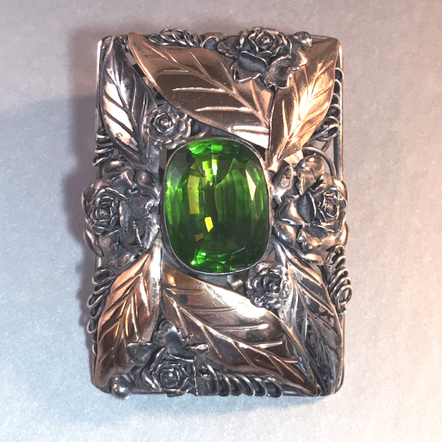 HOBE sterling silver rectangular fur clip with a beautiful green stone