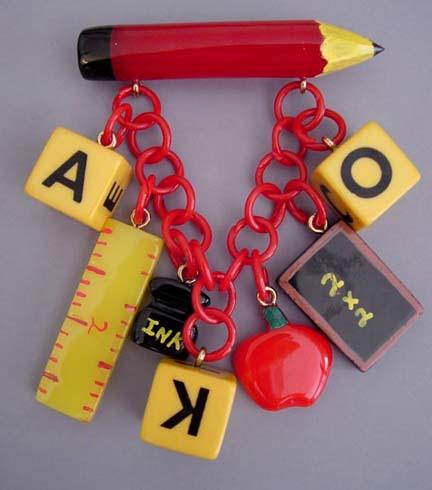 SHULTZ bakelite school days pin with carved red pencil, butterscotch alphabet blocks