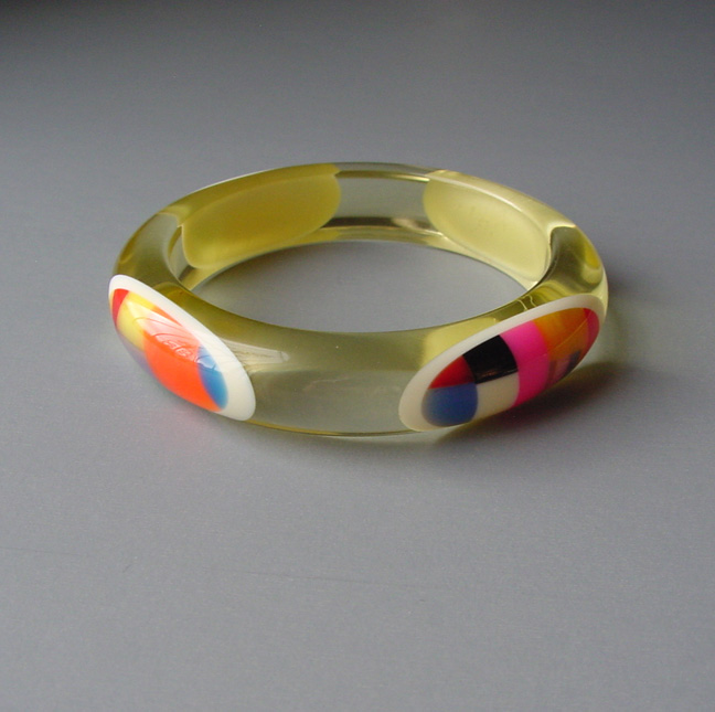 SHULTZ bakelite bangle with cheerful multi-colored oval dots