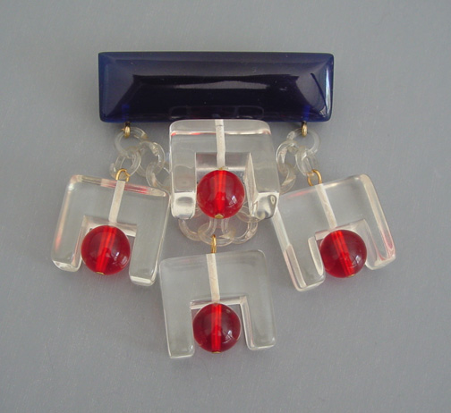 SHULTZ bakelite and Lucite clear, transparent red and deep transparent blue dangles brooch