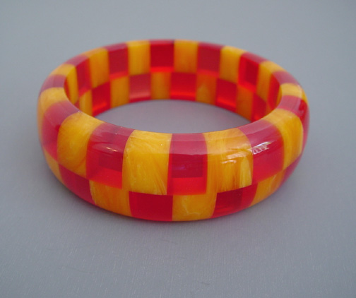 SHULTZ two-row checks bangle in wonderful colors of transparent red and marbled tangerine orange