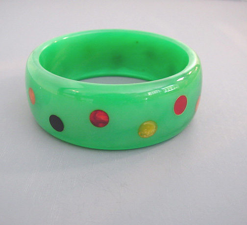 SHULTZ bakelite green slightly marbled and translucent bangle with multi-colored confetti dots