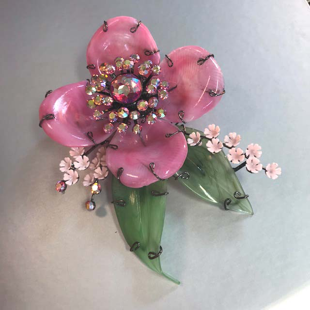 LARRY VRBA flower brooch with pink and green glass petals and leaves accented by pink rhinestones