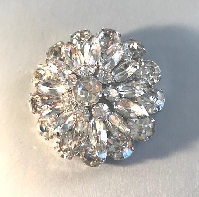 CLEAR rhinestones round brooch in a silver tone setting
