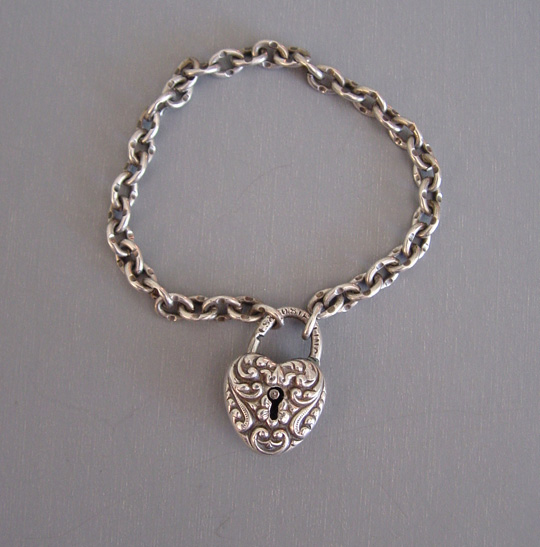 S&Co sterling silver puffy heart padlock charm on a child size link chain