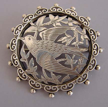 VICTORIAN sterling silver round pierced and etched bird design brooch with a beaded edge, circa 1880