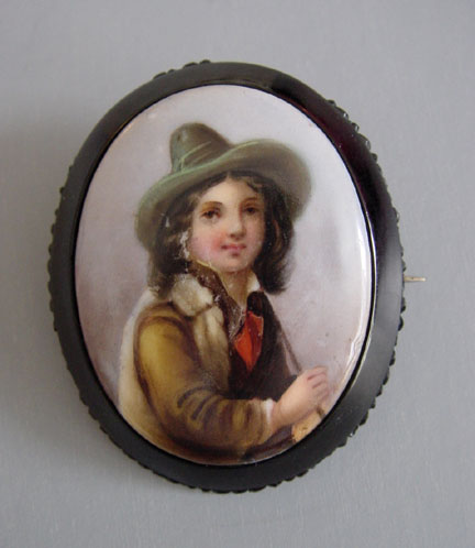 VICTORIAN antique Whitby jet brooch with a painted porcelain miniature