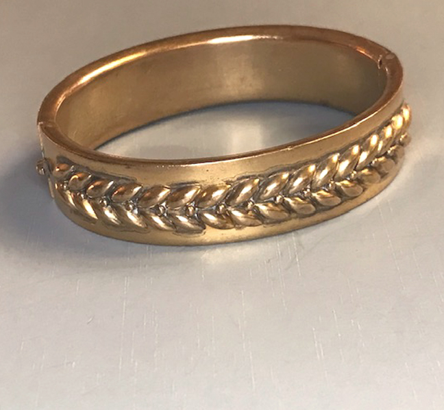 VICTORIAN gold colored metal hinged bangle with applied leaves
