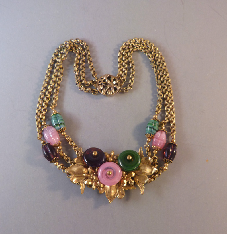 MIRIAM HASKELL by Frank Hess necklace of pink, purple and green glass beads on gold tone chains