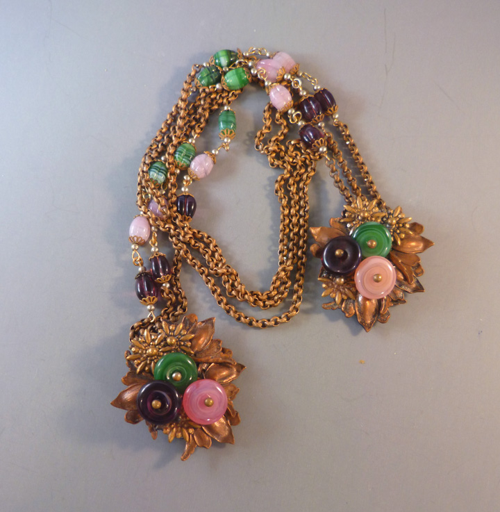 MIRIAM HASKELL Hess pink, green, purple flattened glass beads lariat necklace with leaves and chains