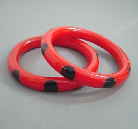 SHULTZ bakelite red tube bangles with eight black fingernail dots each