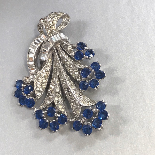DEROSA dress clip clear round, baguette rhinestones, medium blue rhinestones in a silver rhodium setting