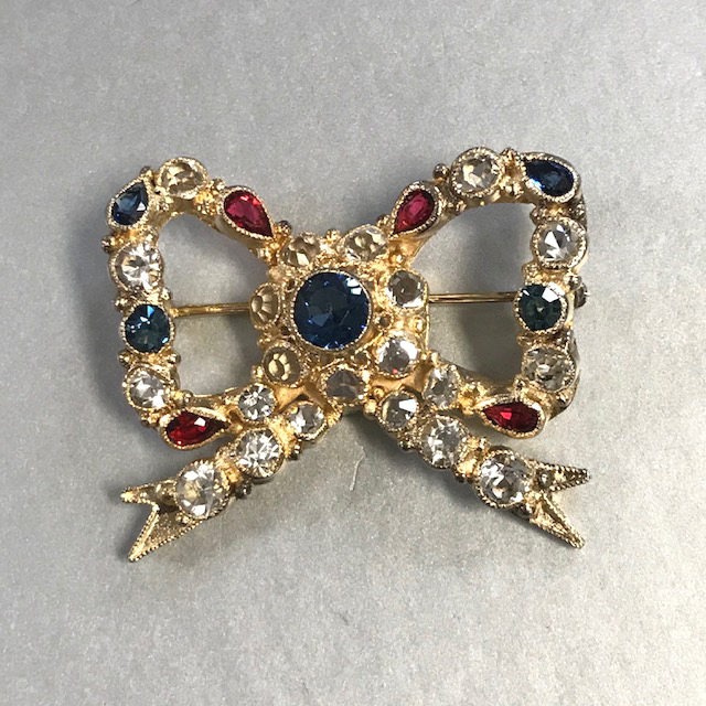 HOBE bow brooch in gold washed sterling with red, clear and blue rhinestones