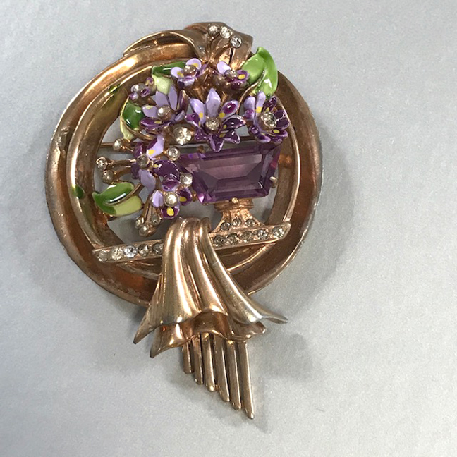 DEROSA purple and green basket brooch with a lovely unfoiled purple center rhinestone surrounded by lavender and green enameled flowers