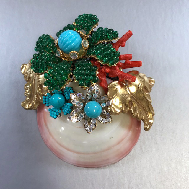 LARRY VRBA sea shell brooch decorated by a bouquet of flowers and leaves